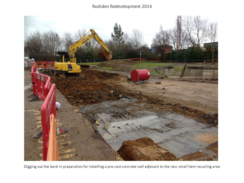 Digging out the grass bank in preparation for installing the pre-cast concrete wall Rushden Redevelopment 2014