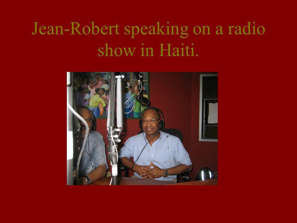 Jean-Robert speaking on a radio show in Haiti.