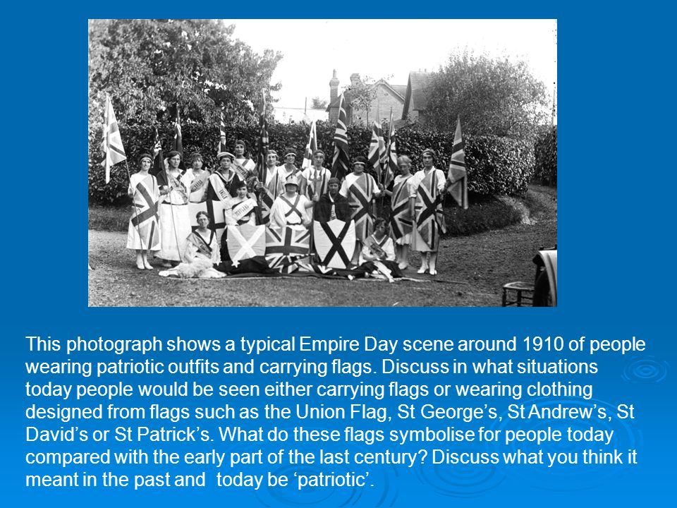 This photograph shows a typical Empire Day scene around 1910 of people wearing patriotic outfits and carrying flags.