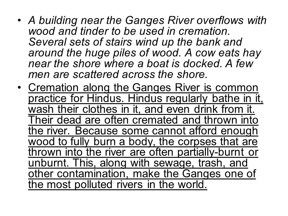 A building near the Ganges River overflows with wood and tinder to be used in cremation. Several sets of stairs wind up the bank and around the huge p
