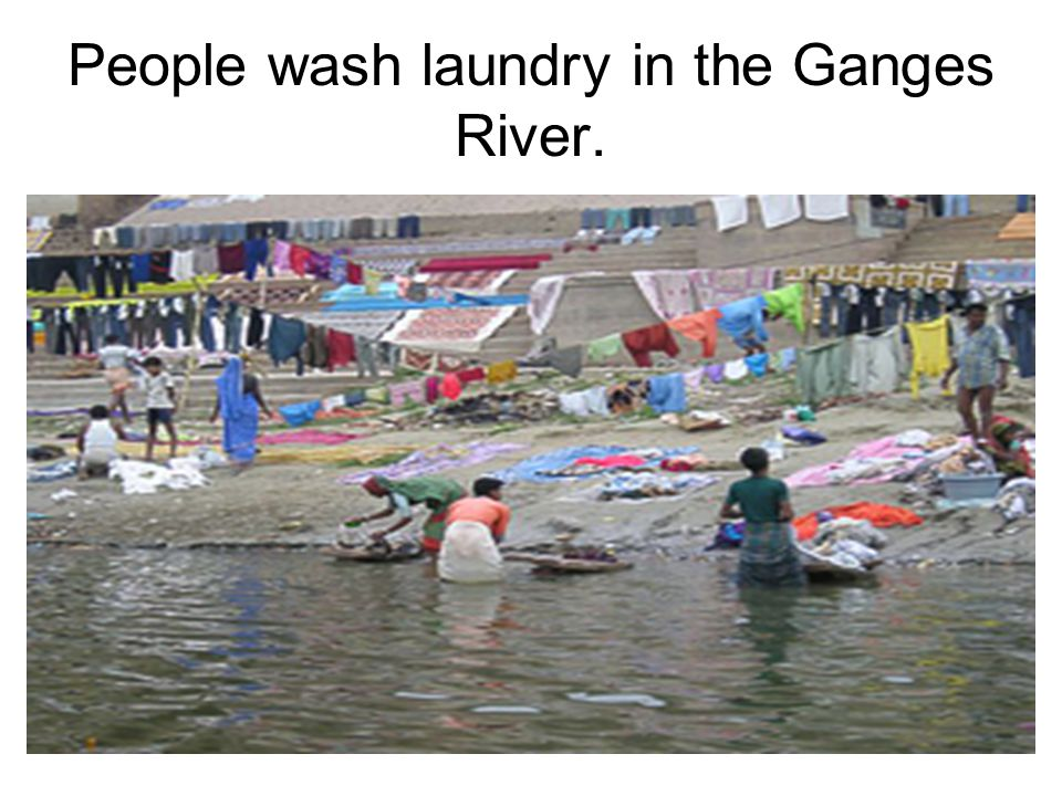 People wash laundry in the Ganges River.