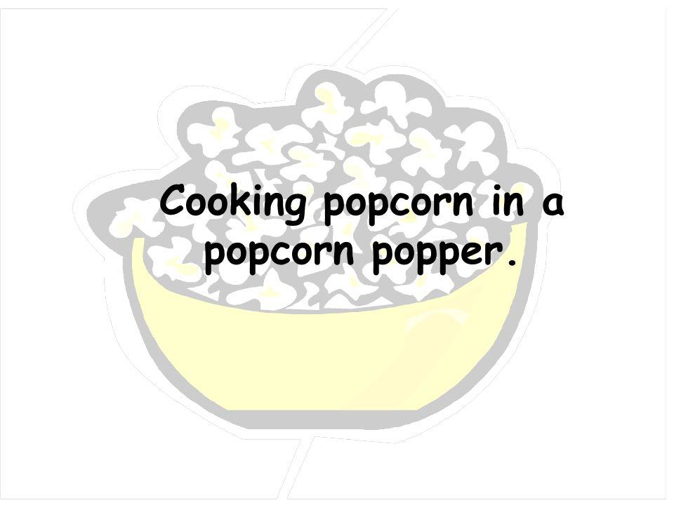 Cooking popcorn in a popcorn popper.