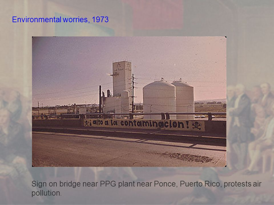 Environmental worries, 1973 Sign on bridge near PPG plant near Ponce, Puerto Rico, protests air pollution.