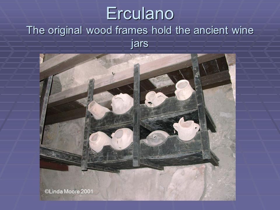 Erculano The original wood frames hold the ancient wine jars ©Linda Moore 2001