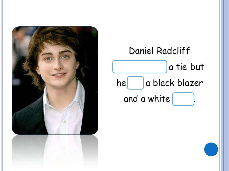 Daniel Radcliff doesn't have a tie but he has a black blazer and a white shirt.