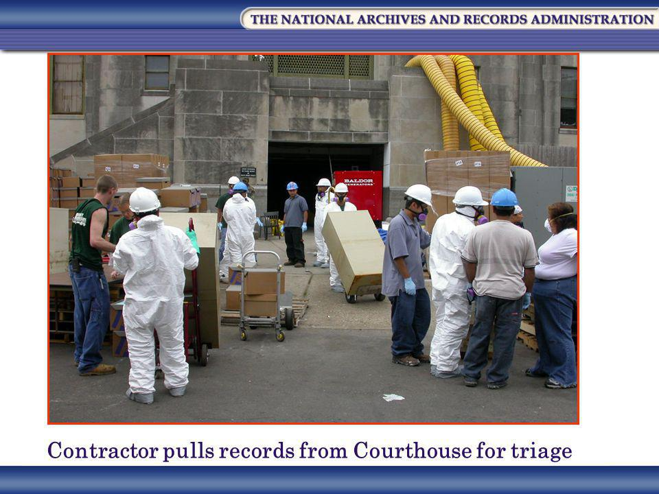 Contractor pulls records from Courthouse for triage