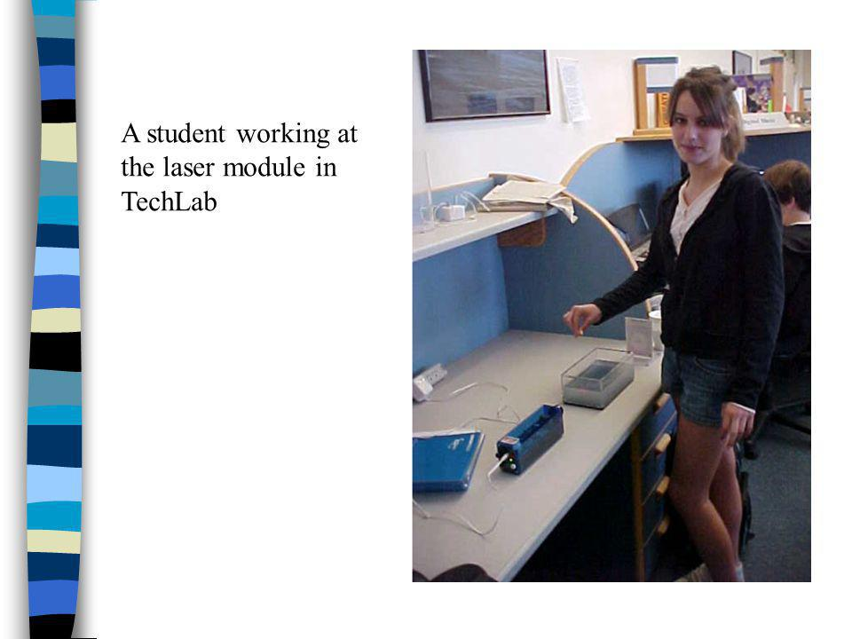 A student working at the laser module in TechLab