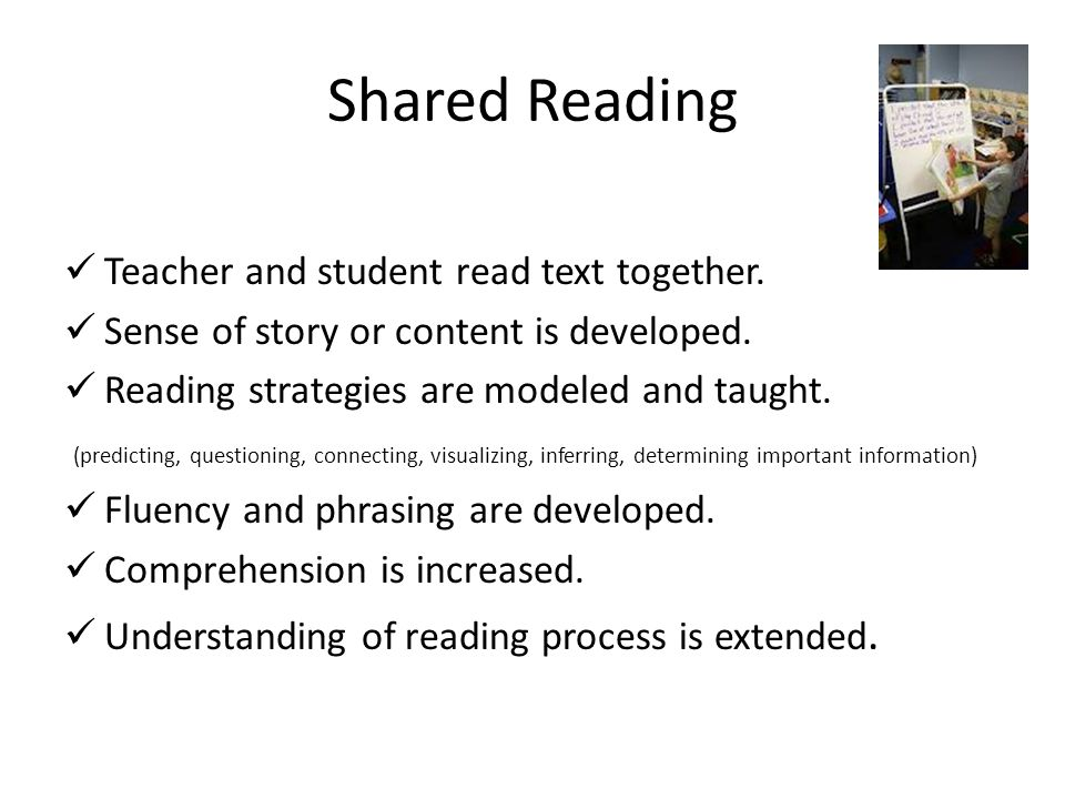 Shared Reading Teacher and student read text together.