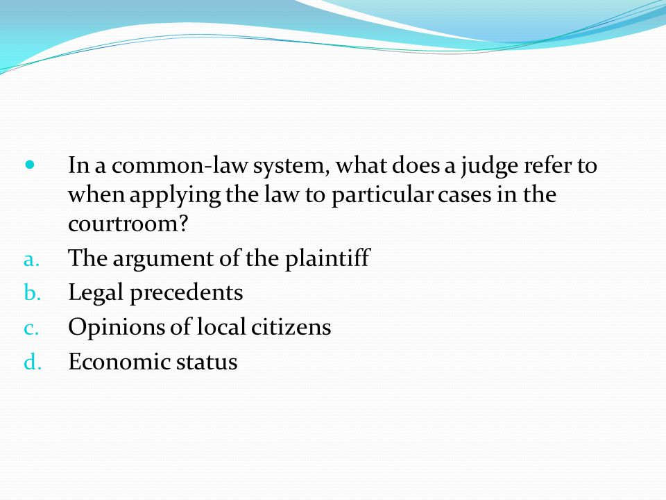 In a common-law system, what does a judge refer to when applying the law to particular cases in the courtroom.