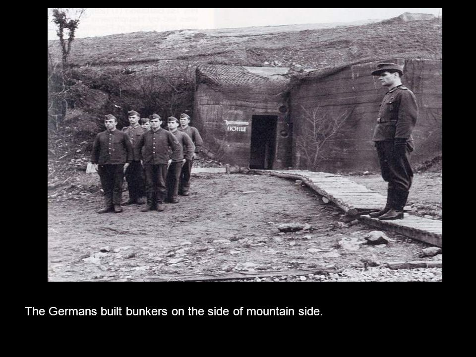 The Germans built bunkers on the side of mountain side.
