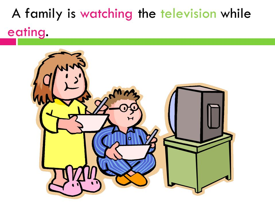 A family is watching the television while eating.
