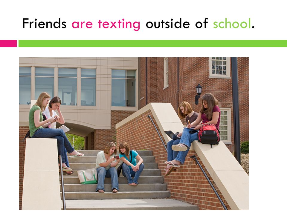 Friends are texting outside of school.