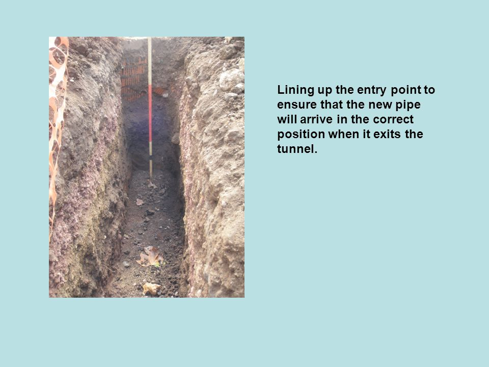 Lining up the entry point to ensure that the new pipe will arrive in the correct position when it exits the tunnel.