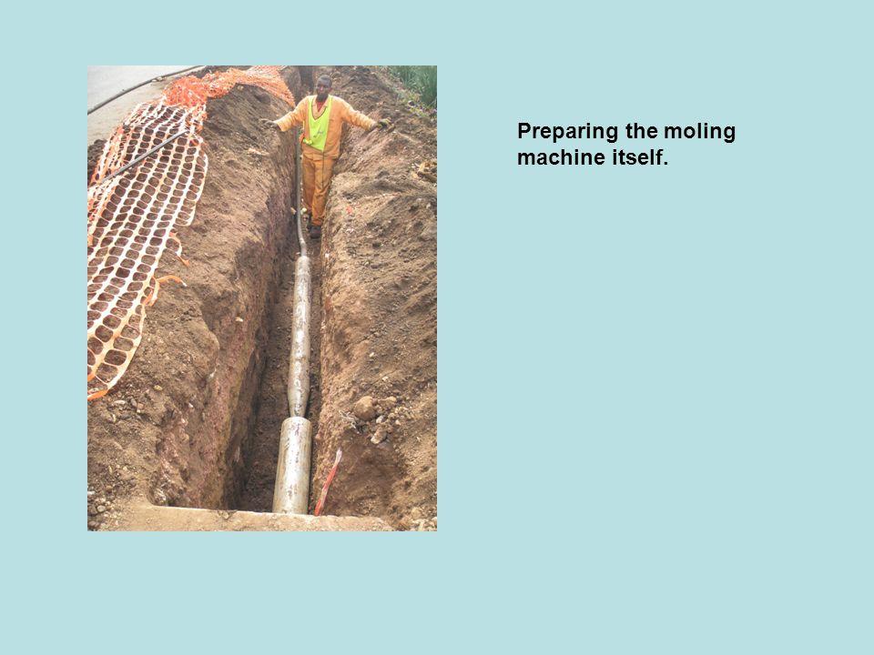 Preparing the moling machine itself.