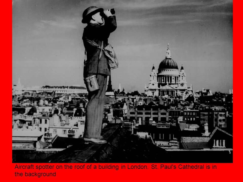 Aircraft spotter on the roof of a building in London. St. Paul s Cathedral is in the background