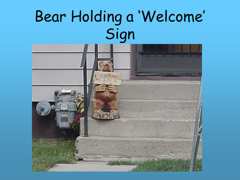 Bear Holding a 'Welcome' Sign