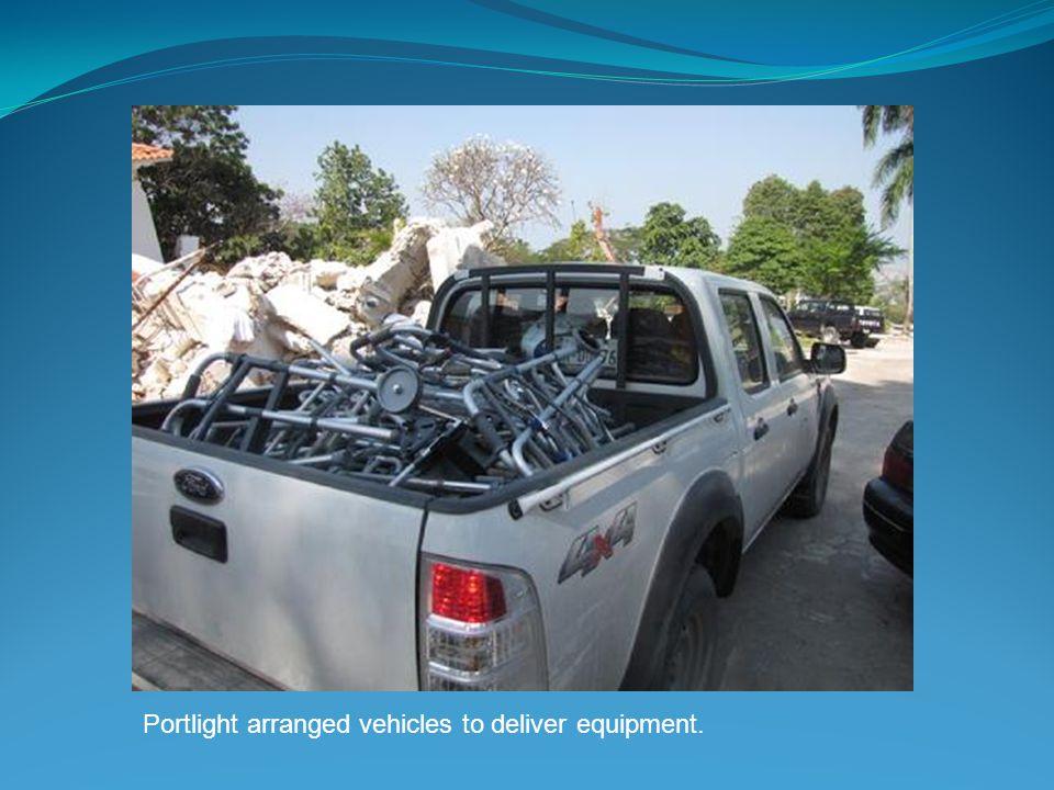 Portlight arranged vehicles to deliver equipment.