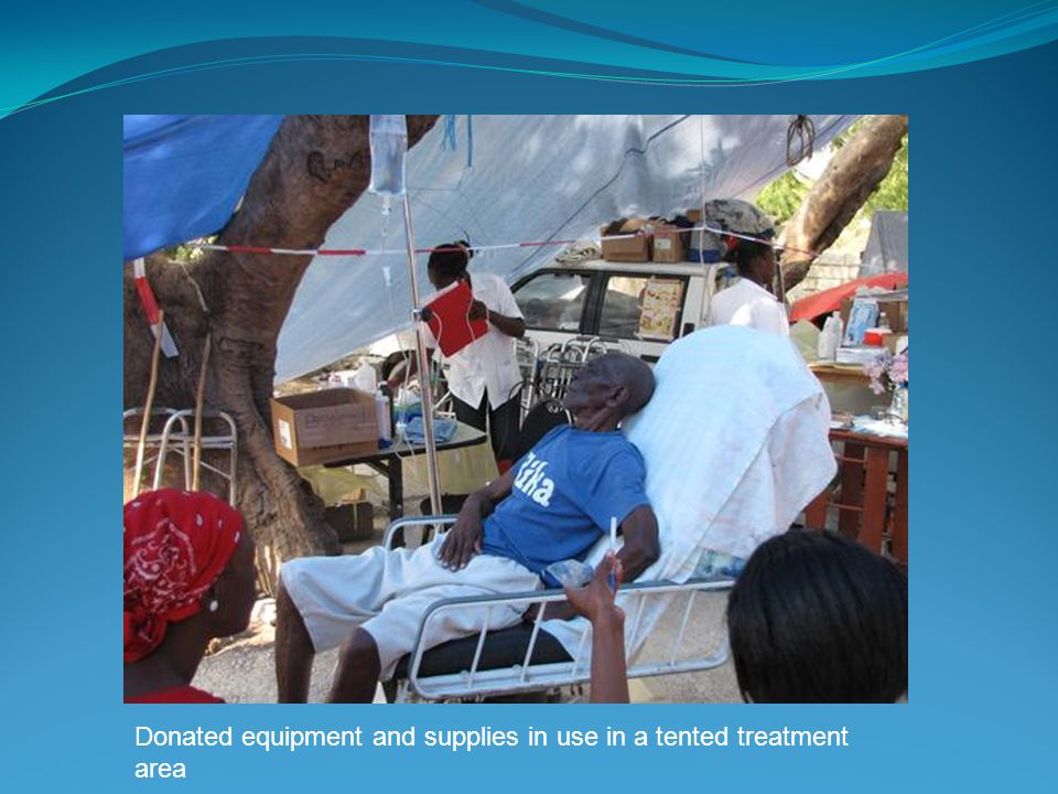 Donated equipment and supplies in use in a tented treatment area