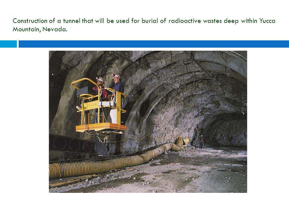 Construction of a tunnel that will be used for burial of radioactive wastes deep within Yucca Mountain, Nevada.