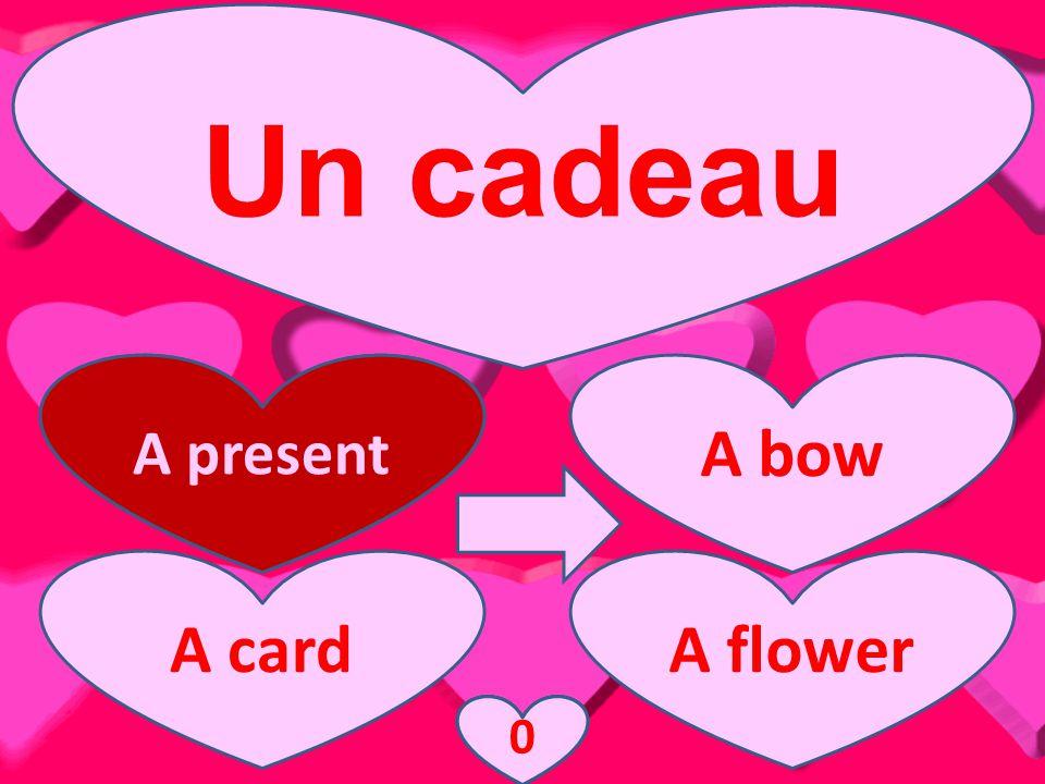 Un cadeau A present A bow A cardA flower A present 3210