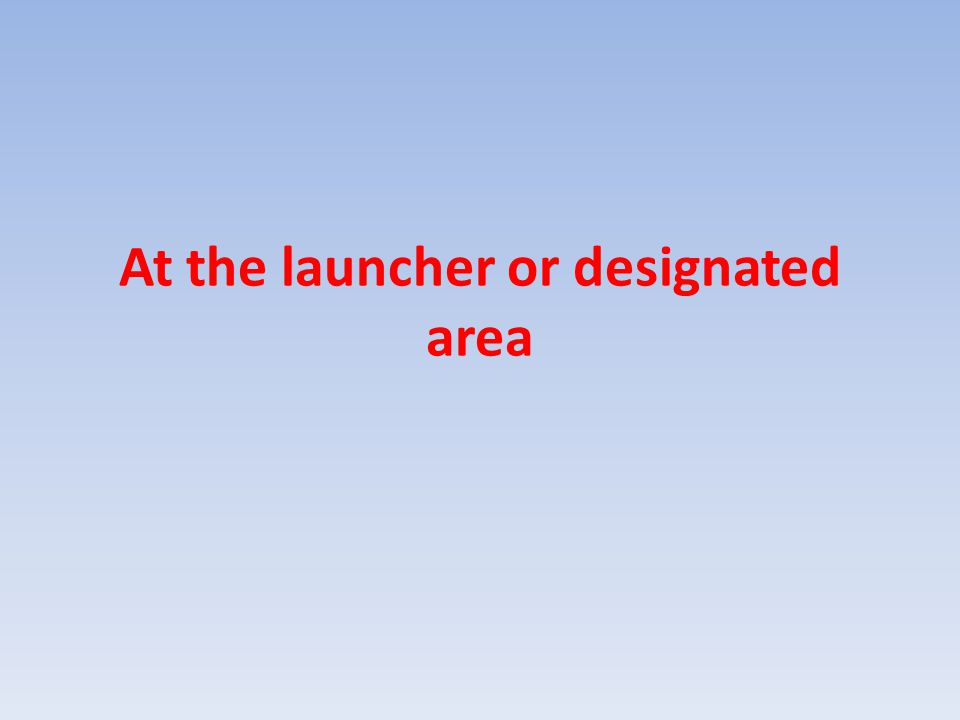At the launcher or designated area