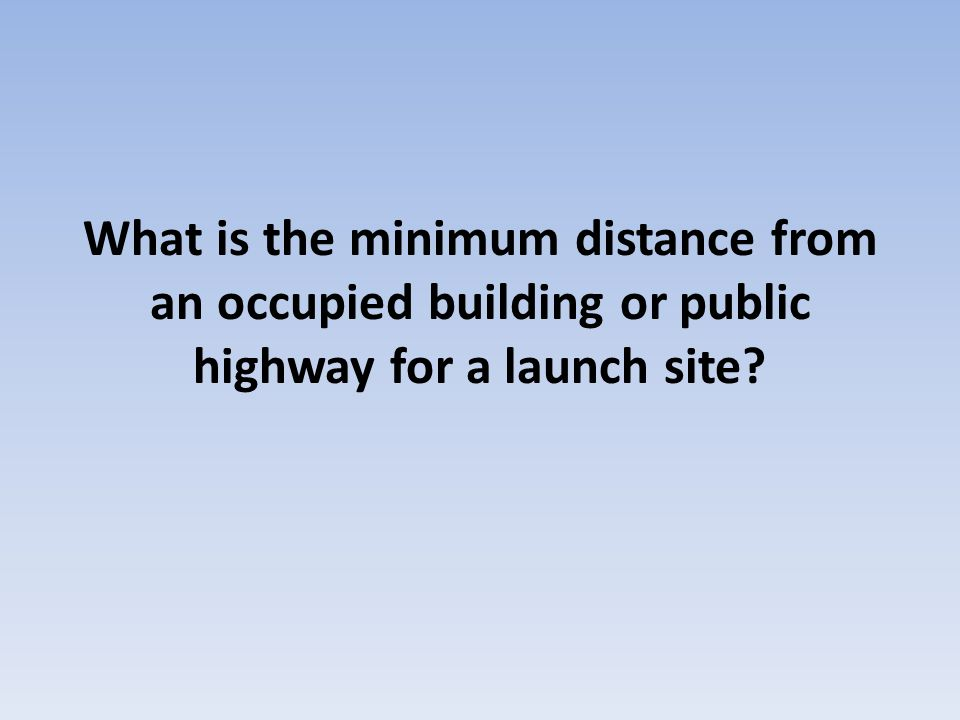 What is the minimum distance from an occupied building or public highway for a launch site?