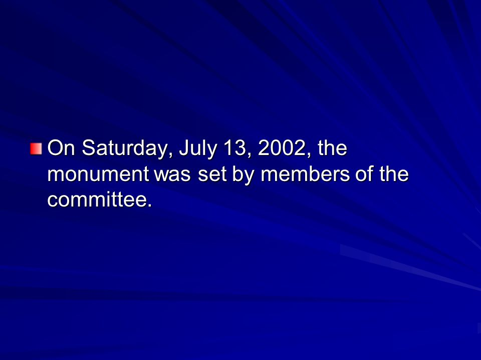 On Saturday, July 13, 2002, the monument was set by members of the committee.