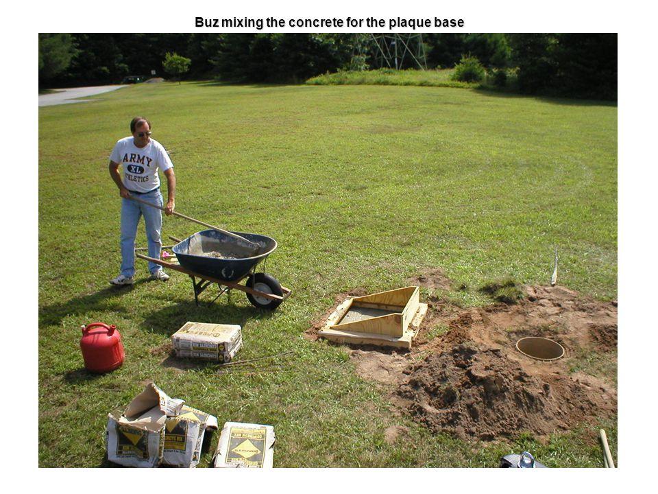 Buz mixing the concrete for the plaque base
