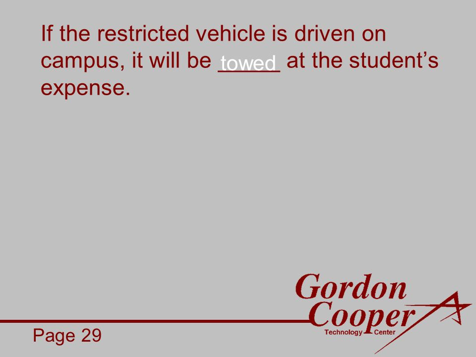If the restricted vehicle is driven on campus, it will be _____ at the students expense.