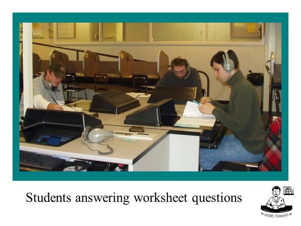 Students answering worksheet questions