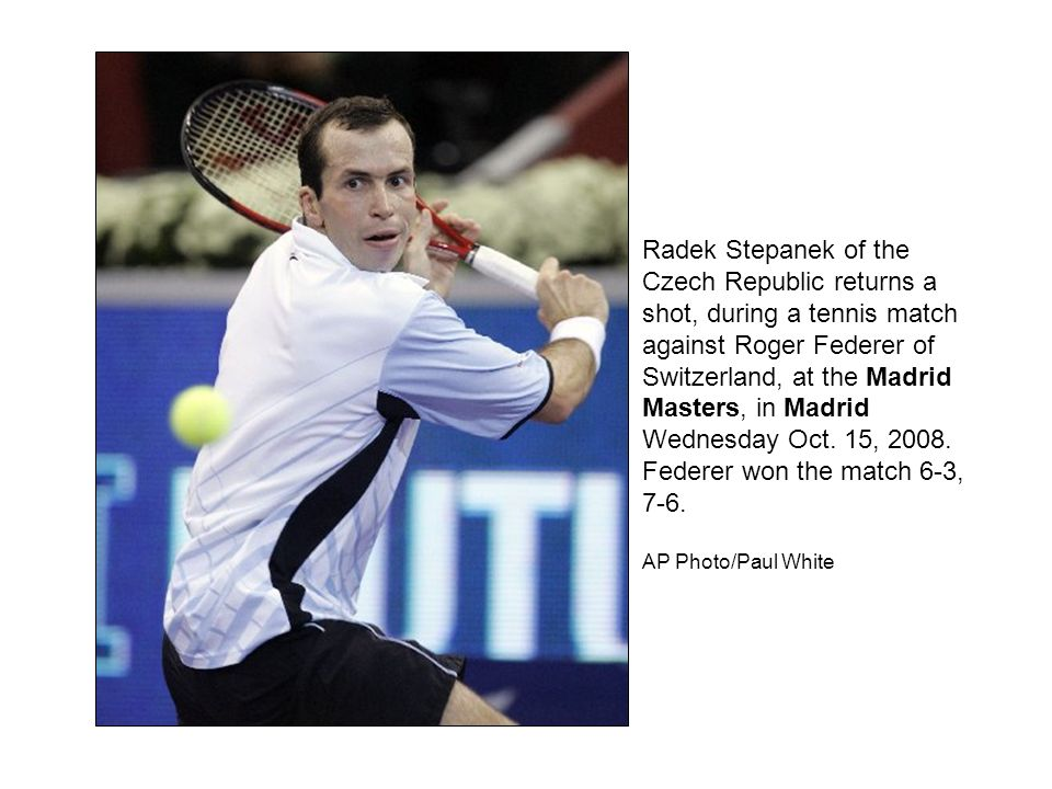 Radek Stepanek of the Czech Republic returns a shot, during a tennis match against Roger Federer of Switzerland, at the Madrid Masters, in Madrid Wednesday Oct.