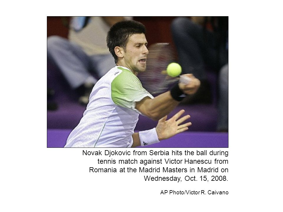 Novak Djokovic from Serbia hits the ball during tennis match against Victor Hanescu from Romania at the Madrid Masters in Madrid on Wednesday, Oct.