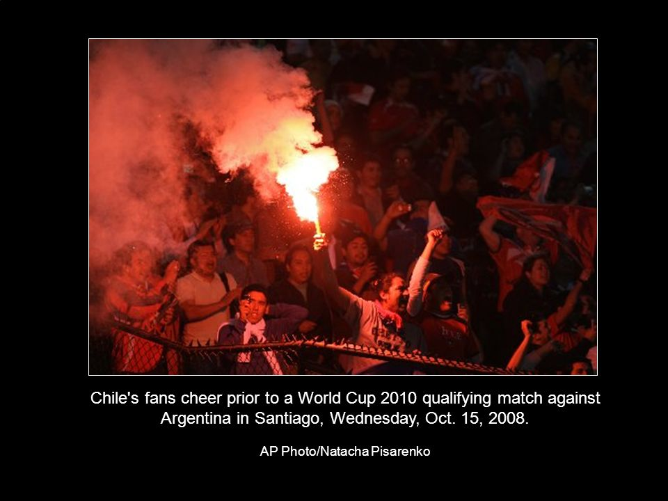 Chile s fans cheer prior to a World Cup 2010 qualifying match against Argentina in Santiago, Wednesday, Oct.