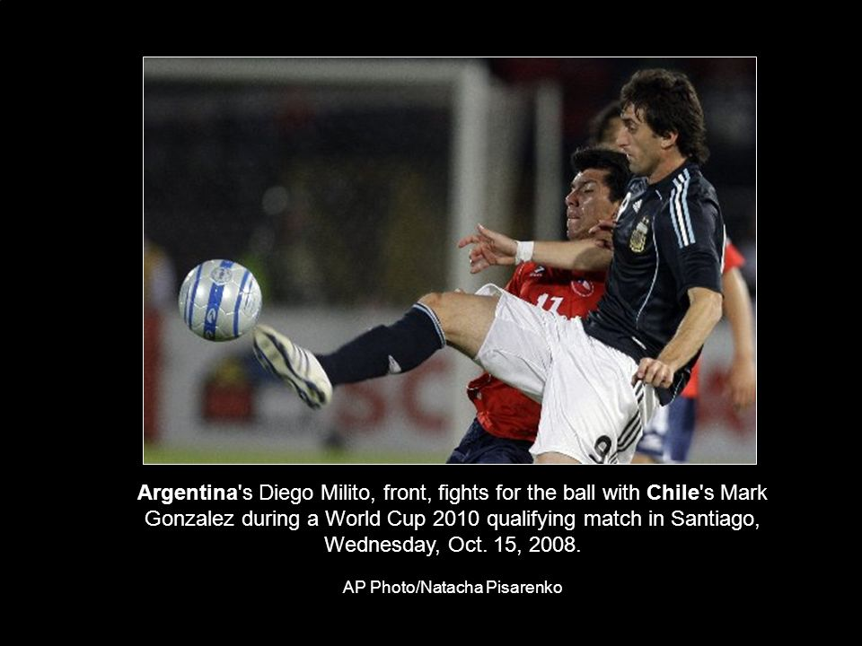 Argentina s Diego Milito, front, fights for the ball with Chile s Mark Gonzalez during a World Cup 2010 qualifying match in Santiago, Wednesday, Oct.