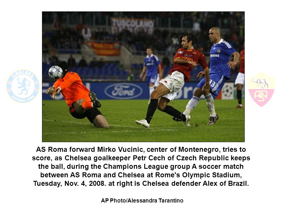 AS Roma forward Mirko Vucinic, center of Montenegro, tries to score, as Chelsea goalkeeper Petr Cech of Czech Republic keeps the ball, during the Champions League group A soccer match between AS Roma and Chelsea at Rome s Olympic Stadium, Tuesday, Nov.