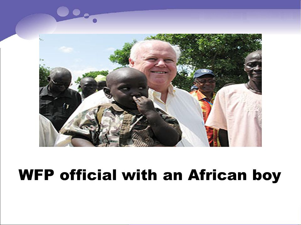WFP official with an African boy