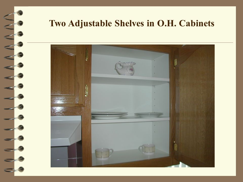 Two Adjustable Shelves in O.H. Cabinets