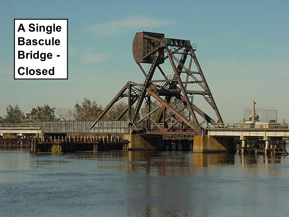 DOUBLE BASCULE BRIDGE Open 180° Red Pier Lights 180° Red Moveable Span Light is off.
