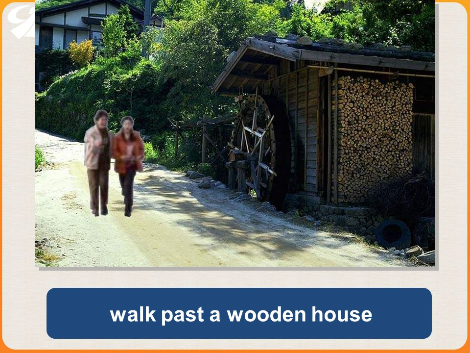 walk past a wooden house