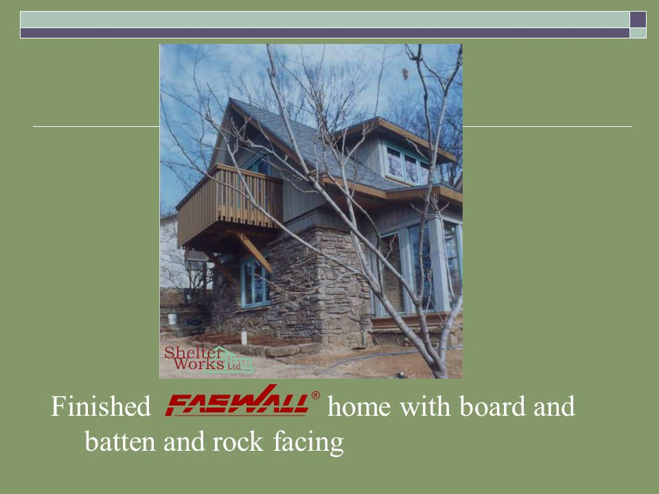 Finished home with board and batten and rock facing