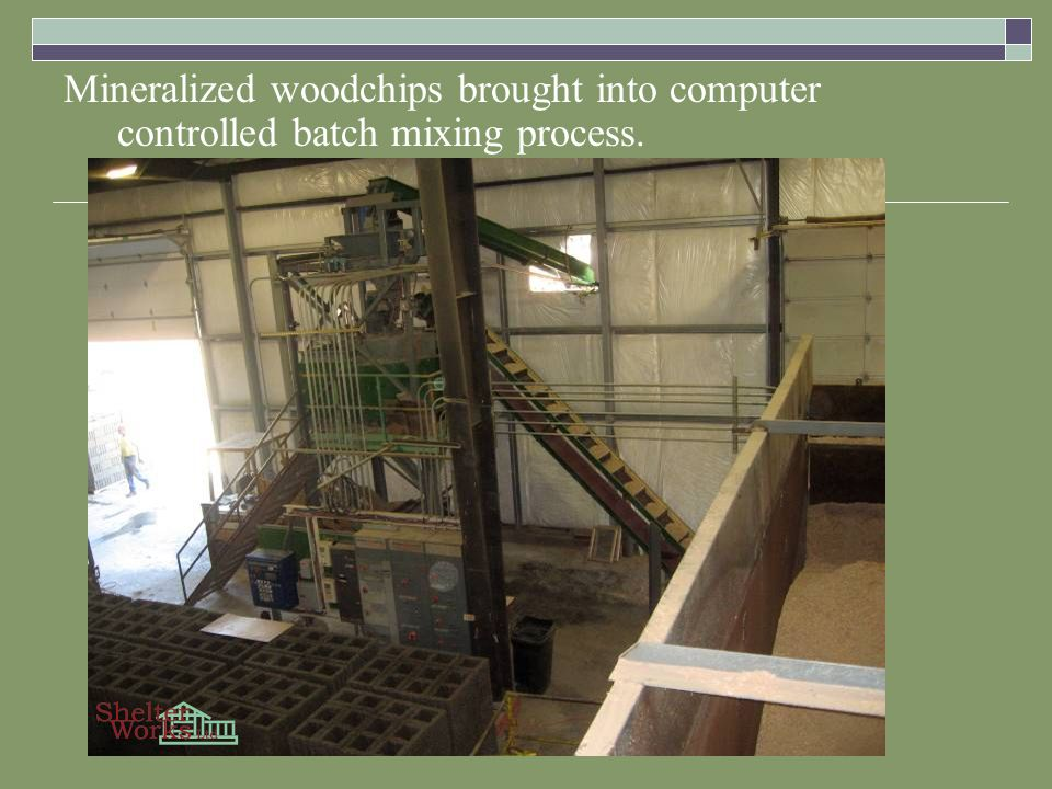 Mineralized woodchips brought into computer controlled batch mixing process.