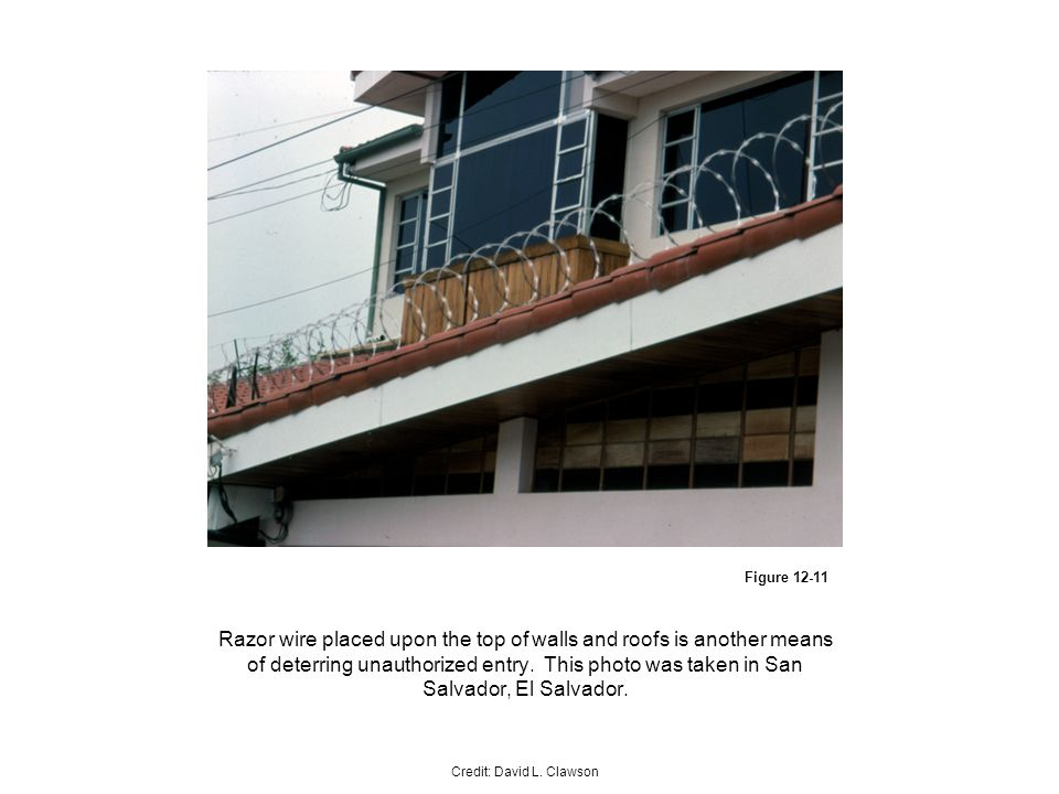 Figure Razor wire placed upon the top of walls and roofs is another means of deterring unauthorized entry.
