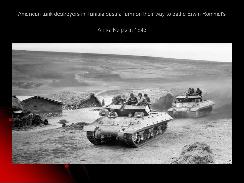 American tank destroyers in Tunisia pass a farm on their way to battle Erwin Rommel s Afrika Korps in 1943
