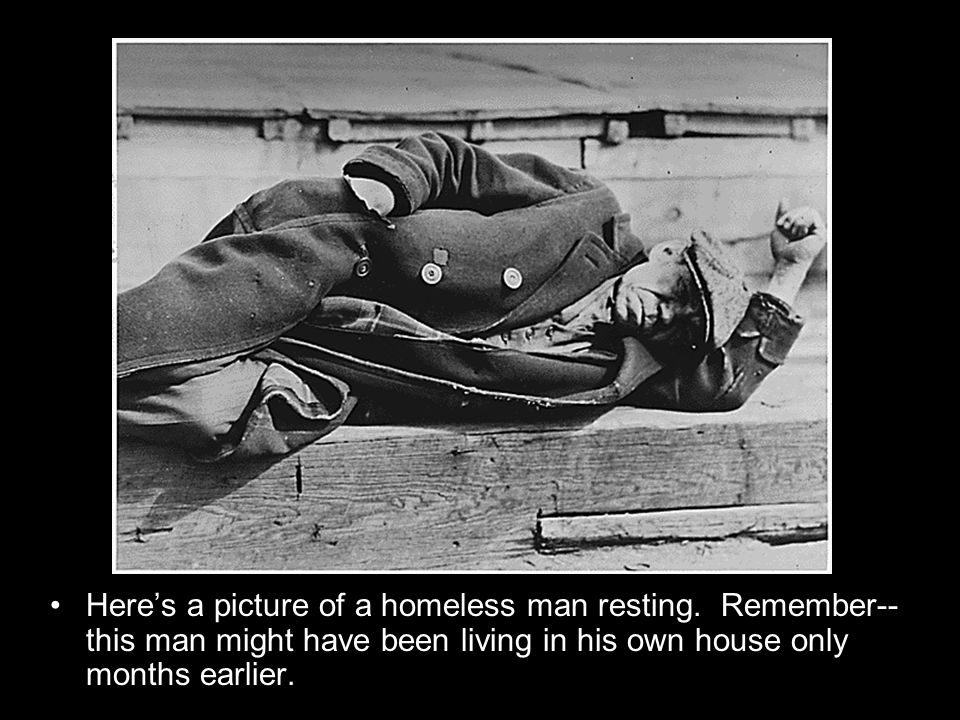 Heres a picture of a homeless man resting.
