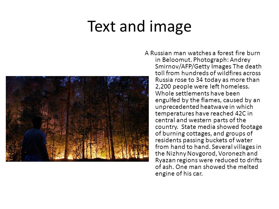 Text and image A Russian man watches a forest fire burn in Beloomut.
