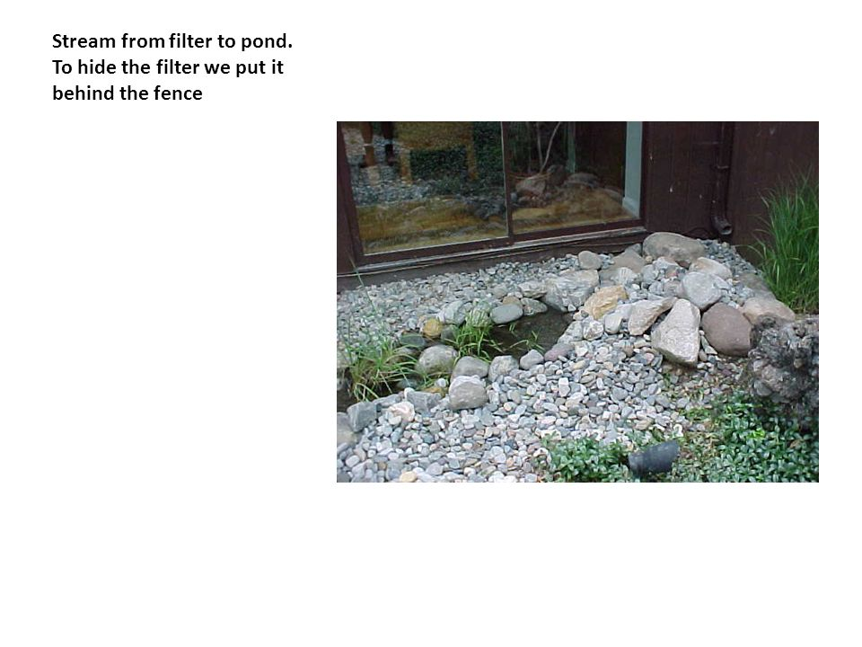 Stream from filter to pond. To hide the filter we put it behind the fence