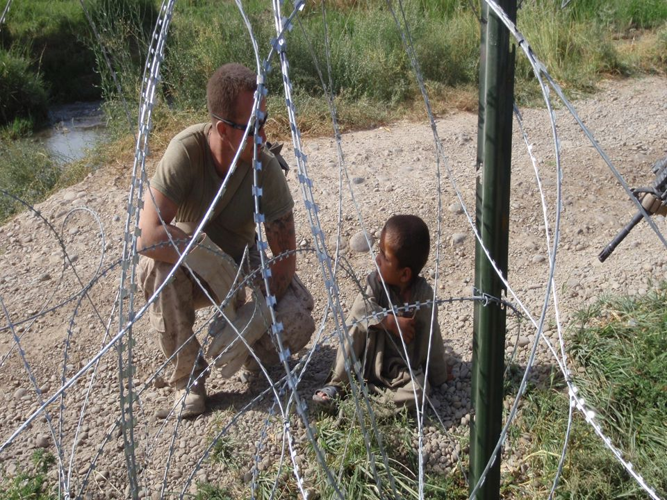 A soldier speaks with children in Afghanistan today http://www.afghanconflictmonitor.org/2008/05/index.html
