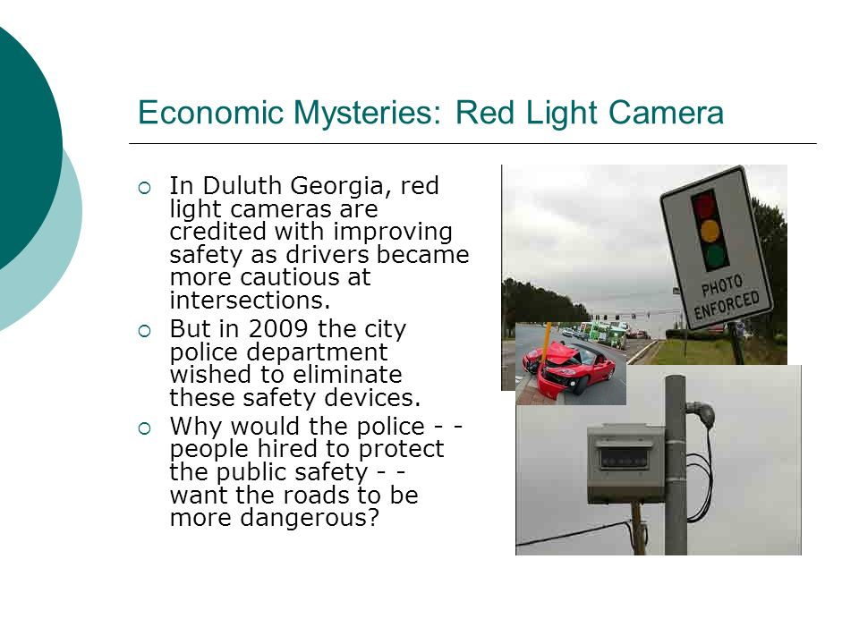 Economic Mysteries: Red Light Camera In Duluth Georgia, red light cameras are credited with improving safety as drivers became more cautious at intersections.