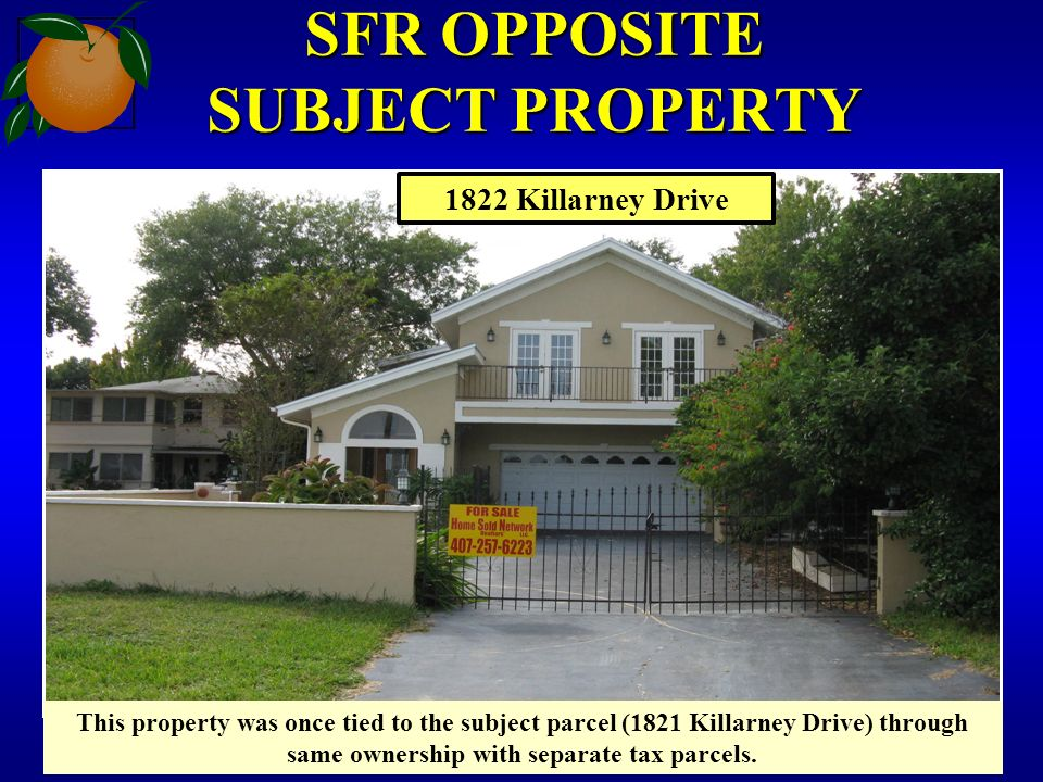 SFR OPPOSITE SUBJECT PROPERTY This property was once tied to the subject parcel (1821 Killarney Drive) through same ownership with separate tax parcels.