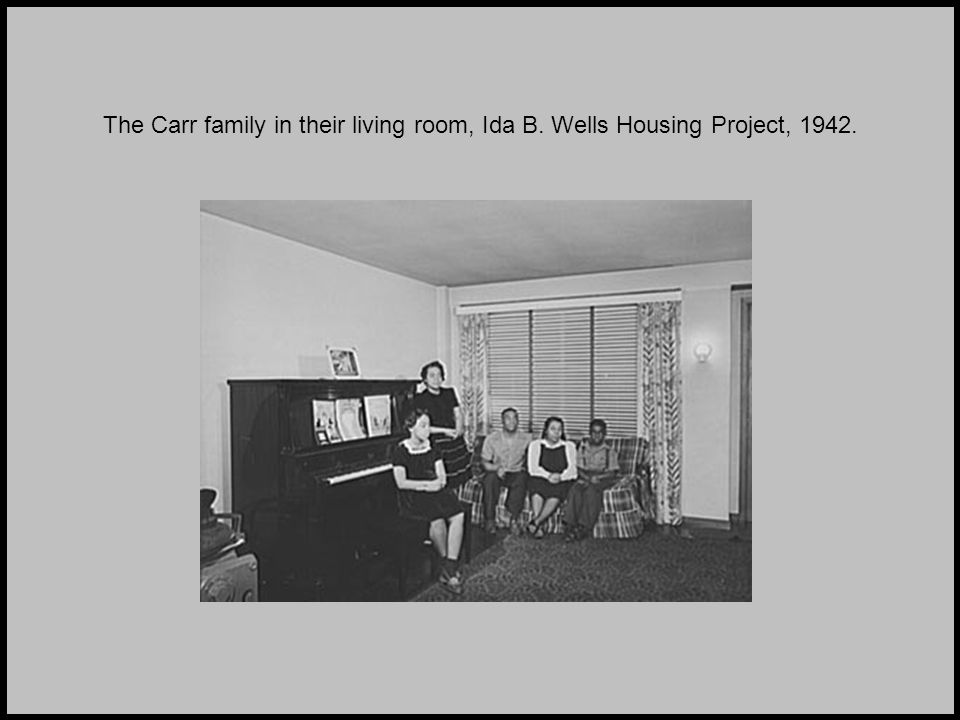 The Carr family in their living room, Ida B. Wells Housing Project, 1942.